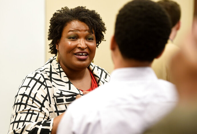 Former gubernatorial candidate Stacey Abrams talks to reporters after campaigning for District 1 Commission candidate Jordan Johnson at the Tabernacle Baptist Church Family Life Center in Augusta, Ga., Friday, Jan. 31, 2019.  (Michael Holahan/The Augusta Chronicle via AP)