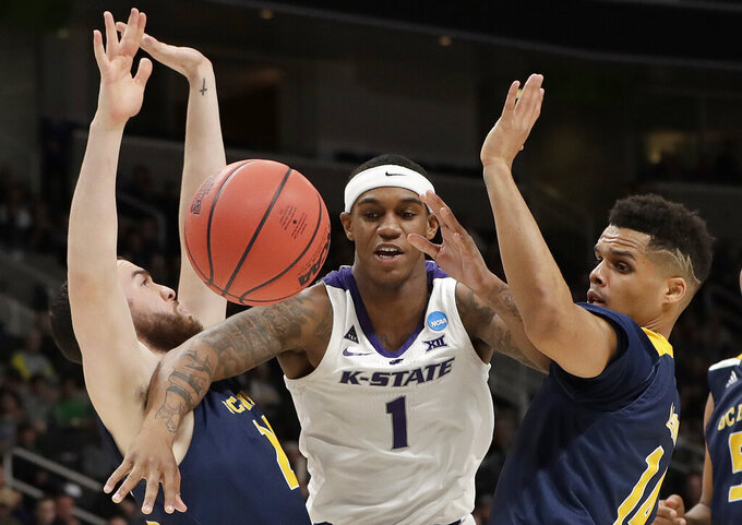 CORRECTS IDENTIFICATION OF THE PLAYER AT LEFT TO SPENCER RIVERS, AND NOT DARRIAN TRAYLOR AS ORIGINALLY SENT - Kansas State guard Shaun Neal-Williams (1) loses the ball between UC Irvine guards Spencer Rivers, left, and Evan Leonard during the first half of a first round men's college basketball game in the NCAA Tournament Friday, March 22, 2019, in San Jose, Calif. (AP Photo/Chris Carlson)