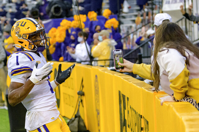 LSU wide receiver Kayshon Boutte (1) reacts after making a touchdown against Mississippi during the first half of an NCAA college football game in Baton Rouge, La., Saturday, Dec. 19, 2020. (AP Photo/Matthew Hinton)