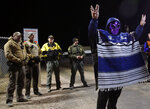 A man in an alien mask stands at an entrance to the Nevada Test and Training Range near Area 51 Friday, Sept. 20, 2019, outside of Rachel, Nev. People gathered at the gate inspired by the