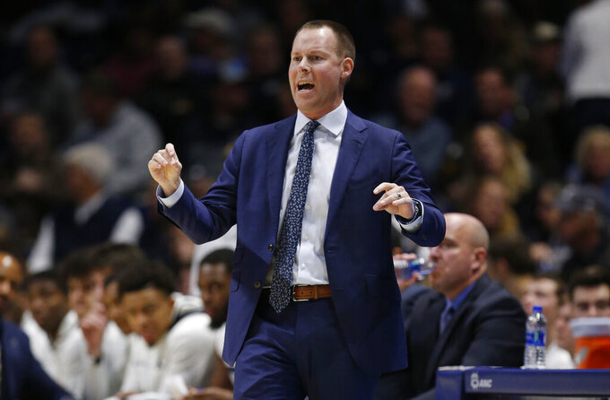 Xavier head coach Travis Steele gives his team instruction against Missouri State during the first half of an NCAA college basketball game, Friday, Nov. 15, 2019, in Cincinnati. (AP Photo/Gary Landers)