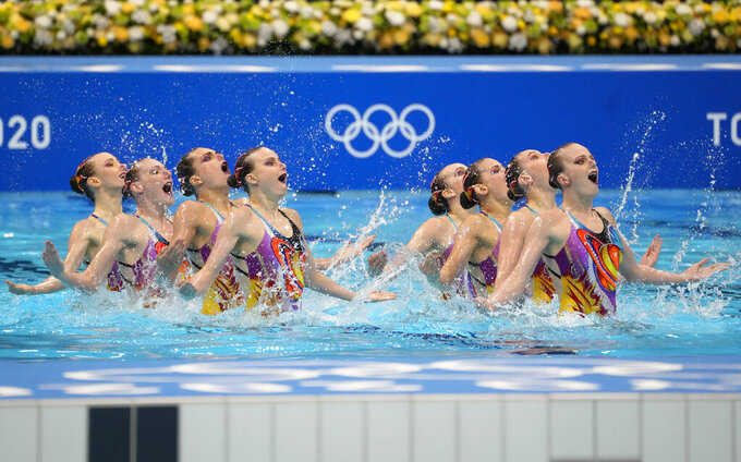 Team of Russian Olympic Committee compete in artistic swimming team, free routine at the 2020 Summer Olympics, Saturday, Aug. 7, 2021, in Tokyo, Japan. (AP Photo/Dmitri Lovetsky)
