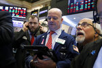 Traders Patrick Casey, center, and Peter Tuchman, right, work on the floor of the New York Stock Exchange, Friday, Feb. 8, 2019. Stocks are opening lower on Wall Street as a mixed bag of earnings reports didn't inspire investors to get back to buying stocks. (AP Photo/Richard Drew)
