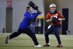 New England Patriots quarterback Tom Brady looks to pass during NFL football practice, Friday, Feb. 1, 2019, in Atlanta, as the team prepares for Super Bowl 53 against the Los Angeles Rams. (AP Photo/Matt Rourke)
