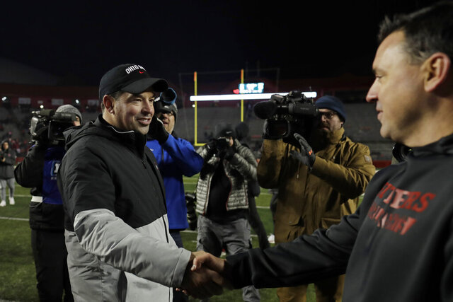 Ohio State head coach Ryan Day shakes hands with Rutgers interim head coach Nunzio Campanile after their NCAA college football game Saturday, Nov. 16, 2019, in Piscataway, N.J. Ohio State won 56-21. (AP Photo/Adam Hunger)