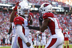 Arizona Cardinals quarterback Kyler Murray, left, is congratulated by Arizona Cardinals wide receiver KeeSean Johnson after scoring against the San Francisco 49ers during the second half of an NFL football game in Santa Clara, Calif., Sunday, Nov. 17, 2019. (AP Photo/Josie Lepe)