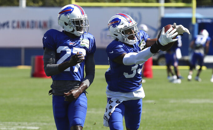 Buffalo Bills cornerback Levi Wallace (39) catches a pass in front of cornerback Tre'Davious White (27) during an NFL football training camp in Orchard Park, N.Y., Monday, Aug. 31, 2020. (James P. McCoy/Buffalo News via AP, Pool)