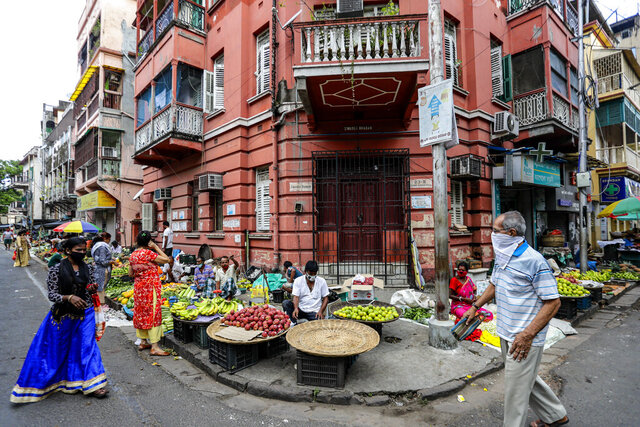 People wearing face masks to prevent the spread of the coronavirus shop for vegetables in Kolkata, India, Tuesday, Sept. 15, 2020. India's coronavirus cases are now the second-highest in the world and only behind the United States. (AP Photo/Bikas Das)
