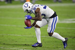 Indianapolis Colts cornerback T.J. Carrie recovers a blocked punt and runs it back for a touchdown against the Tennessee Titans in the second half of an NFL football game Thursday, Nov. 12, 2020, in Nashville, Tenn. (AP Photo/Ben Margot)
