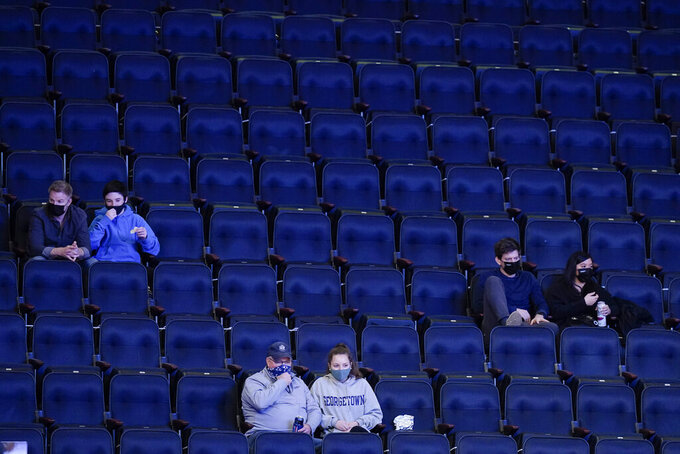 Fans watch the first half of an NCAA college basketball game between Creighton and Connecticut in the semifinals in the Big East men's tournament Friday, March 12, 2021, in New York. (AP Photo/Frank Franklin II)