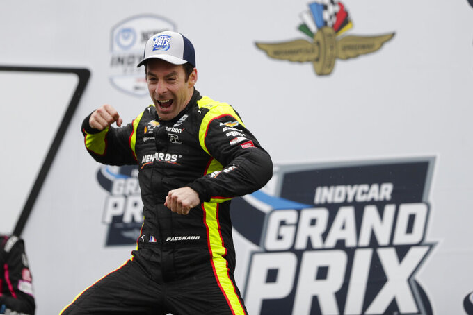 Simon Pagenaud, of France, celebrates after winning the Indy GP IndyCar auto race at Indianapolis Motor Speedway, Saturday, May 11, 2019, in Indianapolis. (AP Photo/Michael Conroy)