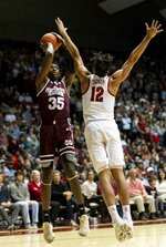 Mississippi State forward Aric Holman (35) shoots a jumper under pressure from Alabama guard Dazon Ingram (12) during the first half of an NCAA college basketball game, Tuesday, Jan. 29, 2019, in Tuscaloosa, Ala. (AP Photo/Vasha Hunt)