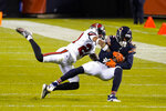 Tampa Bay Buccaneers cornerback Carlton Davis (24) tackles Chicago Bears wide receiver Allen Robinson (12) after a catch during the second half of an NFL football game in Chicago, Thursday, Oct. 8, 2020. (AP Photo/Nam Y. Huh)