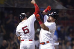 Boston Red Sox's Kyle Schwarber, right, celebrates with Enrique Hernandez (5) after crossing home plate on his two-run home run off Minnesota Twins relief pitcher Alex Colome during the ninth inning of a baseball game at Fenway Park, Wednesday, Aug. 25, 2021, in Boston. (AP Photo/Charles Krupa)