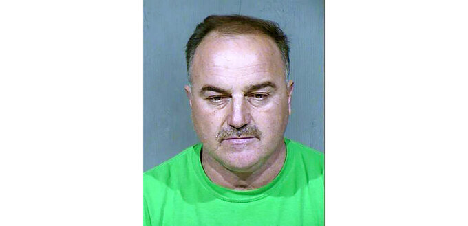 This undated booking photo provided by the Maricopa County Sheriff's Office shows Ali Yousif Ahmed Al-Nouri, an Iraqi man who has been arrested in Arizona as part of an extradition request made by the Iraqi government, which charged him with murder in the 2006 shooting deaths of two police officers in Fallujah. A court hearing for Ahmed is scheduled Tuesday, Feb. 4, 2020, in Phoenix. (Maricopa County Sheriff's Office via AP)