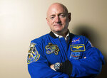 FILE - In this Sept. 26, 2017 file photo, retired astronaut Mark Kelly poses for a portrait at All Saints Episcopal School in Tyler, Texas. Kelly entered the race Tuesday, Feb. 12, 2019, to finish John McCain's term in the U.S. Senate, looking to join a small club of astronauts who have traded an office in outer space for the U.S. Capitol. (Chelsea Purgahn/Tyler Morning Telegraph via AP, File)