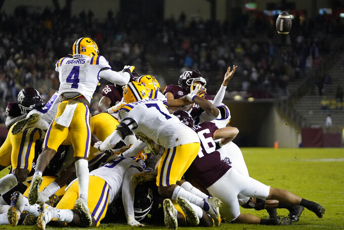 Texas A&M quarterback Kellen Mond (11) has the ball knocked out of his hands by LSU on a fourth-down play during the second quarter of an NCAA college football game Saturday, Nov. 28, 2020, in College Station, Texas. (AP Photo/Sam Craft)