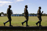 Soldiers patrol outside the president's official residence, Alvorada Palace, in Brasilia, Brazil, Tuesday, July 7, 2020. Brazil's President Jair Bolsonaro said Tuesday he tested positive for COVID-19. (AP Photo/Eraldo Peres)