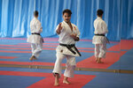 Spanish karate athlete Damian Quinteros, centre, trains in Madrid, Spain, Friday, Feb. 7, 2020. More than five years ago, one of Spain's most successful karate athletes was splitting his time between practice, school and his day job as an aeronautical engineer. Now, nearly five months before the Tokyo Games, Quintero is a full-time karateka and a top contender for the gold medal in Japan. (AP Photo/Paul White)