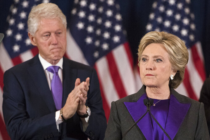 Former President Bill Clinton applauds as his wife, Democratic presidential candidate Hillary Clinton speaks in New York, Wednesday, Nov. 9, 2016, where she conceded her defeat to Republican Donald Trump after the hard-fought presidential election. President Trump and his allies are harking back to his own transition four years ago to make a false argument that his own presidency was denied a fair chance for a clean launch. Press secretary Kayleigh McEnany laid out the case from the White House podium last week and the same idea has been floated by Trump's personal lawyer and his former director of national intelligence. The day after her defeat in 2016, Hillary Clinton conceded. (AP Photo/Matt Rourke)