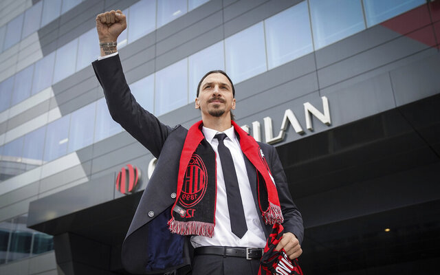 Zlatan Ibrahimovic wears an AC Milan scarf as he acknowledges his fans outside the AC Milan team headquarters, in Milan, Italy, Friday, Jan. 3, 2020.  The 38-year-old striker has been presented by AC Milan after signing a deal until the end of the season with an option to extend for another year. (Spada/LaPresse via AP)