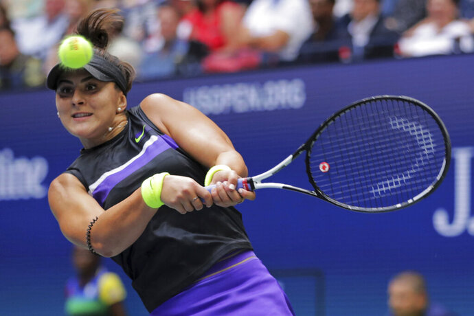 Bianca Andreescu, of Canada, returns a shot to Serena Williams, of the United States, during the women's singles final of the U.S. Open tennis championships Saturday, Sept. 7, 2019, in New York. (AP Photo/Charles Krupa)