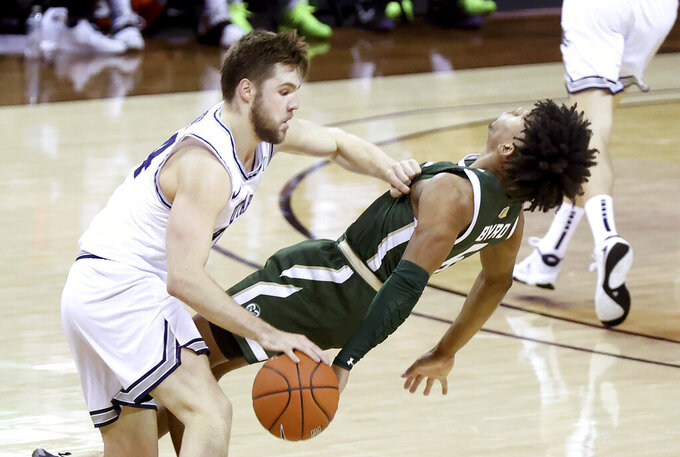 Utah State guard Rollie Worster (24) drives as Colorado State guard P.J. Byrd (5) defends during the second half of an NCAA college basketball game in the semifinal round of the Mountain West Conference men's tournament Friday, March 12, 2021, in Las Vegas. (AP Photo/Isaac Brekken)