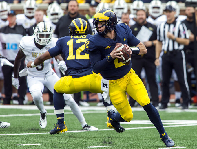 Patterson lives dream: No. 21 Michigan tops W Michigan 49-3
