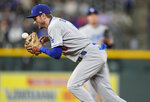 Los Angeles Dodgers shortstop Trea Turner bobbles a ground ball that was ruled a single off the bat of Colorado Rockies' Garrett Hampson in the fourth inning of a baseball game Tuesday, Sept. 21, 2021, in Denver. (AP Photo/David Zalubowski)
