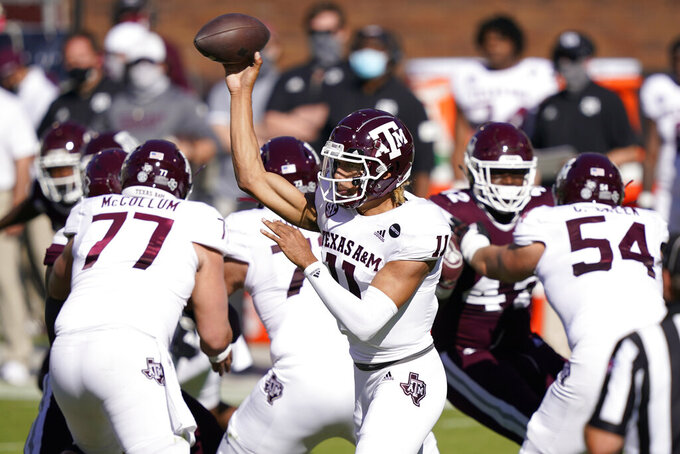 Texas A&M quarterback Kellen Mond (11) passes against Mississippi State during the first half of an NCAA college football game against Mississippi State in Starkville, Miss., Saturday, Oct. 17, 2020. (AP Photo/Rogelio V. Solis)