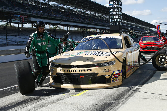 NASCAR Xfinity Series driver Justin Haley makes a pit stop during the NASCAR Xfinity auto race at the Indianapolis Motor Speedway, Saturday, Sept. 7, 2019 in Indianapolis. (AP Photo/Rob Baker)