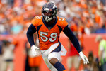 FILE - In this Sept. 15, 2019, file photo, Denver Broncos outside linebacker Von Miller (58) chases a play against the Chicago Bears during the second half of an NFL football game in Denver.  Von Miller is determined to show a so-so 2019 was an oddity, not an omen.  (AP Photo/Jack Dempsey, File)