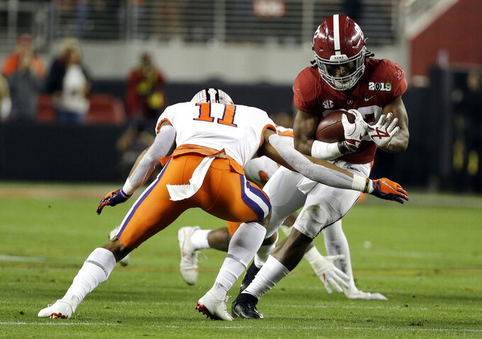 Alabama's Najee Harris runs during the first half the NCAA college football playoff championship game against Clemson, Monday, Jan. 7, 2019, in Santa Clara, Calif. (AP Photo/David J. Phillip)