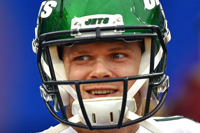 FILE - In this Dec. 29, 2019, file photo, New York Jets quarterback Sam Darnold (14) smiles before an NFL football game against the Buffalo Bills in Orchard Park, N.Y. Darnold was mostly pleased with how he finished last year with the New York Jets. The young quarterback enters his third NFL season knowing he needs to be even better. (AP Photo/Adrian Kraus, File)