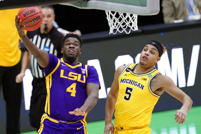 LSU forward Darius Days (4) drives to the basket ahead of Michigan forward Terrance Williams II (5) during the first half of a second-round game in the NCAA men's college basketball tournament at Lucas Oil Stadium Monday, March 22, 2021, in Indianapolis. (AP Photo/AJ Mast)