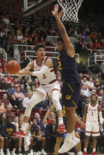 Stanford guard Tyrell Terry (3) looks to pass the ball while defended by California forward Andre Kelly during the first half of an NCAA college basketball game in Stanford, Calif., Thursday, Jan. 2, 2020. (AP Photo/Jeff Chiu)