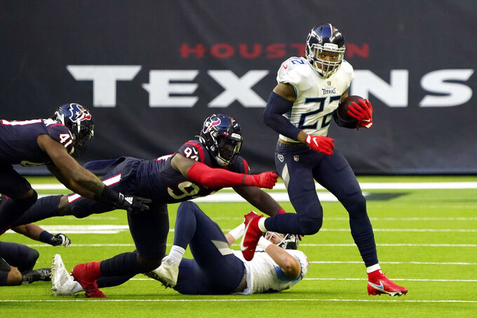 Tennessee Titans running back Derrick Henry (22) breaks away from Houston Texans defensive end Charles Omenihu (94) during the second half of an NFL football game Sunday, Jan. 3, 2021, in Houston. (AP Photo/Sam Craft)