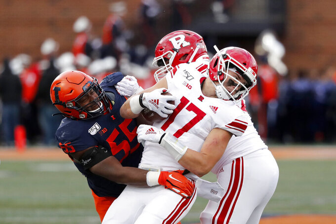 Illinois defensive lineman Jamal Milan (55) tackles Rutgers quarterback Johnny Langan for a loss during the second half of an NCAA college football game Saturday, Nov. 2, 2019, in Champaign, Ill. (AP Photo/Charles Rex Arbogast)