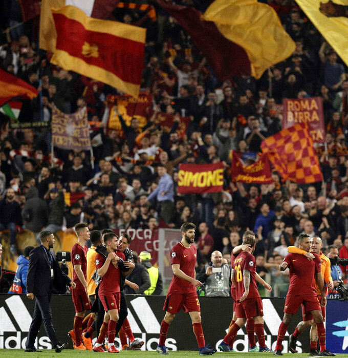 FILE - In this April 10, 2018, file photo, Roma player celebrate at the end of the Champions League quarterfinal second-leg soccer match against FC Barcelona at Rome's Olympic Stadium. (AP Photo/Andrew Medichini, File)