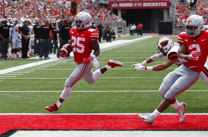 Ohio State running back Mike Weber, left, scores a touchdown against Oregon State during the first half of an NCAA college football game Saturday, Sept. 1, 2018, in Columbus, Ohio. (AP Photo/Jay LaPrete)
