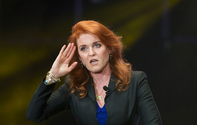 "FILE - In this Monday, March 7, 2016 file photo, Sarah Ferguson, Duchess of York, salutes during a press event, in Mexico City. Ferguson has landed a book deal for her debut novel for adults, a historical romance fictionalizing the life and loves of her great-great-great aunt. In a promotional video posted on her Twitter account Wednesday, Jan. 13, 2021 the former Sarah Ferguson said the novel is set in the Victorian era and is ""about daring to follow your heart against the odds."" (AP Photo/Rebecca Blackwell, file)"
