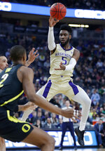 Washington's Jaylen Nowell (5) passes the ball against Oregon during the first half of an NCAA college basketball game in the final of the Pac-12 men's tournament Saturday, March 16, 2019, in Las Vegas. (AP Photo/John Locher)