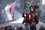 People attend celebrations in Minsk, Belarus, Sunday, March 24, 2019, on the eve of March 25, a traditional day of demonstration for the opposition. Many people gather to mark what they call Freedom Day, on the 101st anniversary of the 1918 declaration of the first, short-lived independent Belarus state, the Belarusian People's Republic lasted until 1919. (AP Photo/Sergei Grits)