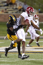 Alabama wide receiver DeVonta Smith, right, is tackled by Missouri's Ennis Rakestraw Jr.,left, during the second half of an NCAA college football game Saturday, Sept. 26, 2020, in Columbia, Mo. (AP Photo/L.G. Patterson)