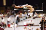 FILE - In this 1968 file photo, Dick Fosbury, of the United States, clears the bar in the high jump competition at the 1968 Mexico City Olympics. Fosbury is celebrated for the