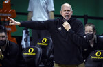Colorado coach Tad Boyle gestures during the first half of the team's NCAA college basketball game against Oregon on Thursday, Feb. 18, 2021, in Eugene, Ore. (AP Photo/Andy Nelson)