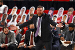 Texas Tech coach Chris Beard yells out to his team during the first half of an NCAA college basketball game against Sam Houston State, Friday, Nov. 27, 2020, in Lubbock, Texas. (AP Photo/Brad Tollefson)