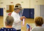 Jo Shepard collects her ballot at Bixby North Elementary School in Bixby, Okla., on Tuesday, June 30, 2020. (Matt Barnard/Tulsa World via AP)