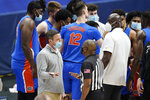 An official explains the ruling to Florida head coach Mike White after Florida's Omar Payne fouled Tennessee's John Fulkerson in the second half of an NCAA college basketball game in the Southeastern Conference Tournament Friday, March 12, 2021, in Nashville, Tenn. Payne was ejected from the game. (AP Photo/Mark Humphrey)