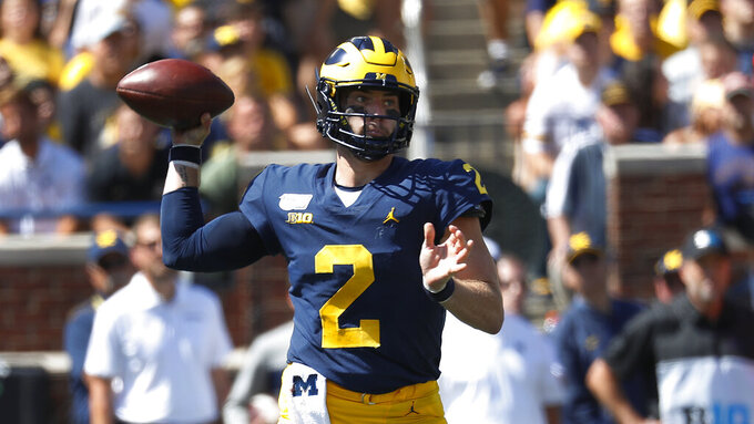 Michigan quarterback Shea Patterson throws against Army in the first half of an NCAA college football game in Ann Arbor, Mich., Saturday, Sept. 7, 2019. (AP Photo/Paul Sancya)